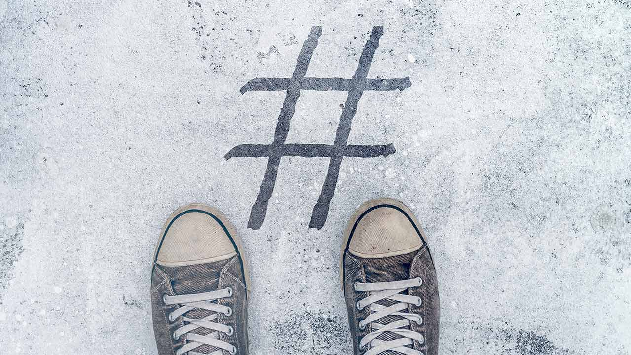 hashtag spray painted on sidewalk